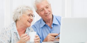 elderly couple looking at the laptop